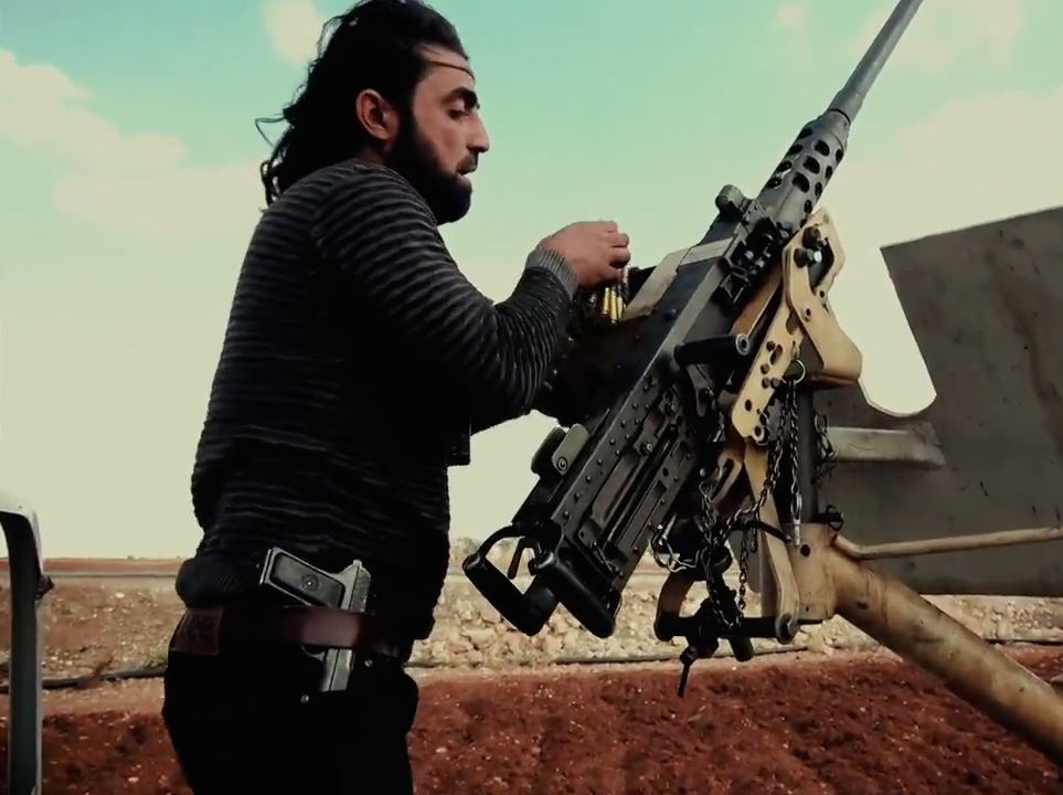 A Free Syrian Army fighter loads a U.S.-made M2 Browning heavy machine gun in northern Aleppo in November 2016. Credit: Mada Media via Wikimedia Commons.