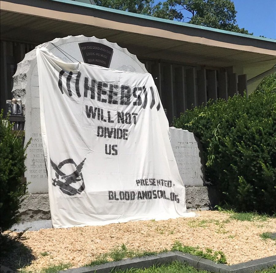 The anti-Semitic banner posted on a Holocaust memorial in Lakewood, N.J. Credit: ADL New Jersey.