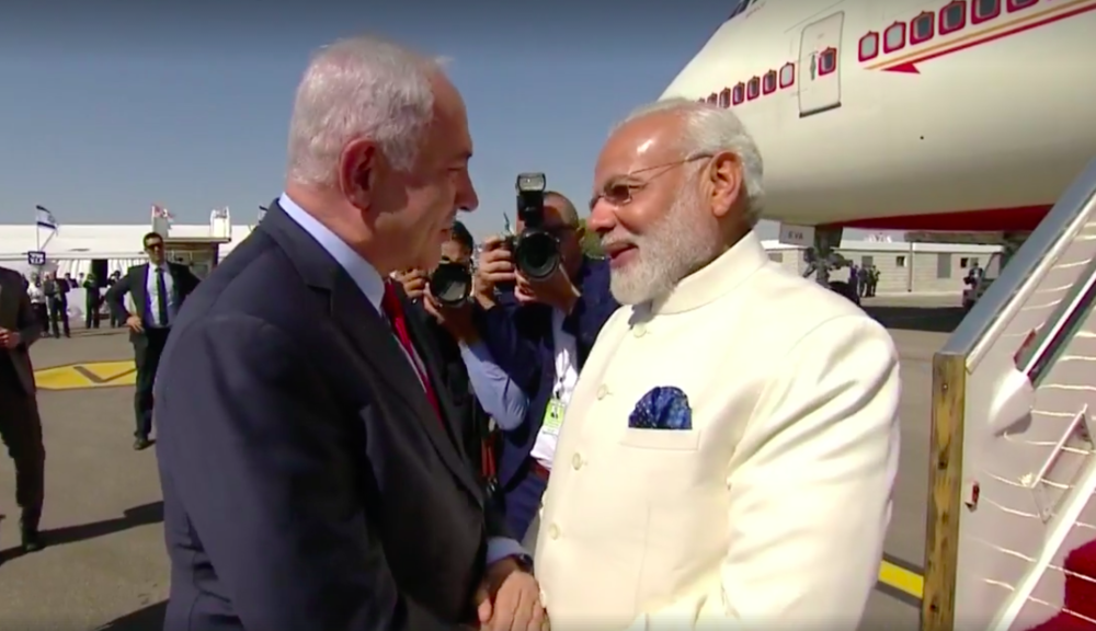 Israeli Prime Minister Benjamin Netanyahu (left) greets Indian Prime Minister Narendra Modi upon Modi's arrival in Israel Tuesday. Credit: Prime Minister Benjamin Netanyahu via Facebook.