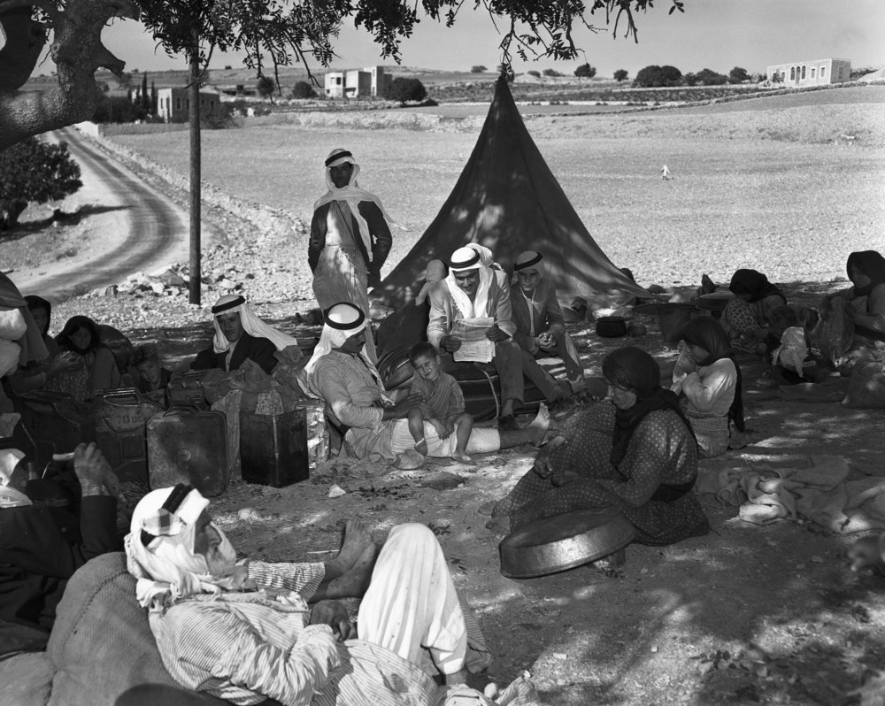 Individuals described by the United Nations as Palestinian refugees are pictured in Lebanon in January 1948. Credit: U.N. Photo.