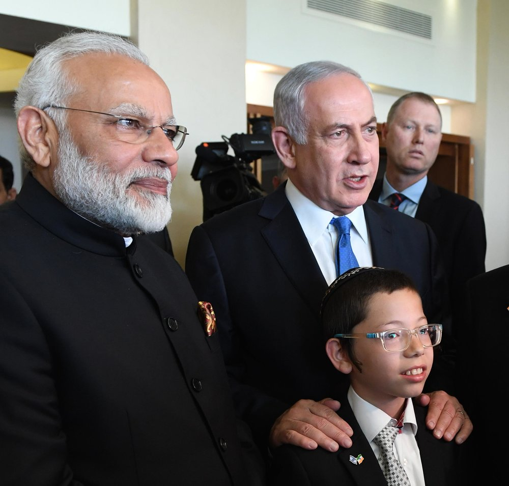 Indian Prime Minister Narendra Modi (left) and Israeli Prime Minister Benjamin Netanyahu meet with 11-year-old Moshe Holtzberg, whose parents were killed in a terror attack on the Chabad House in Mumbai in 2008. Credit: Haim Zach/GPO.