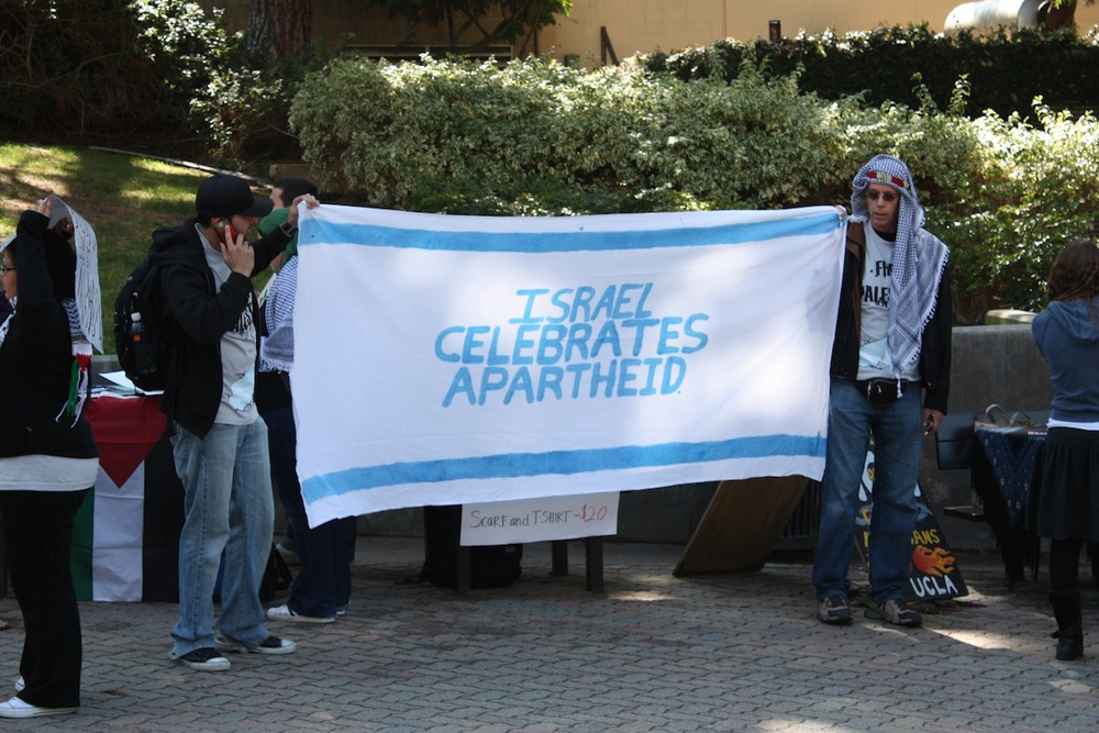 """Israeli Apartheid Week,"" an annual global anti-Israel showcase, in May 2010 on the campus of University of California, Los Angeles. According to the Brand Israel Group, only 54 percent of U.S. college students lean more toward Israel than the Palestinians, down from 73 percent in 2010. Credit: AMCHA Initiative."