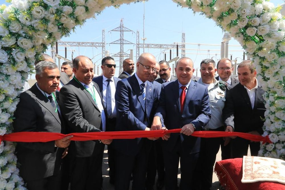 Israeli Energy Minister Yuval Steinitz (fourth from right) and Palestinian Authority Prime Minister Rami Hamdallah (to the left of Steinitz) attend a ribbon-cutting ceremony outside of Jenin to inaugurate the first Palestinian-owned power station. Credit: Twitter.