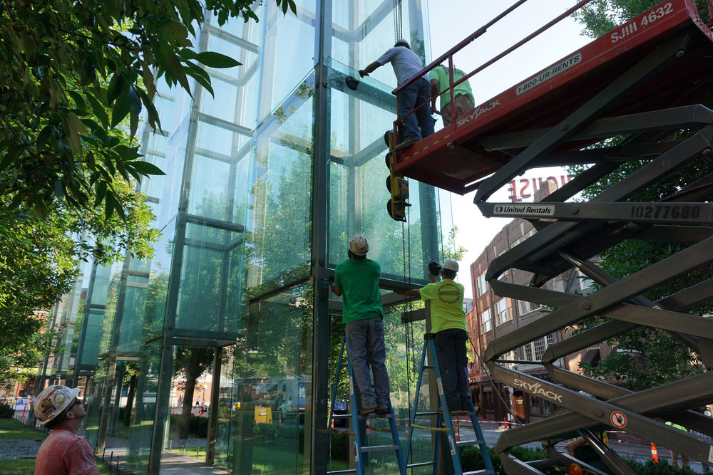 Workers make repairs to the Boston-based New England Holocaust Memorial, which was vandalized in late June and rededicated July 11. Credit: Combined Jewish Philanthropies.