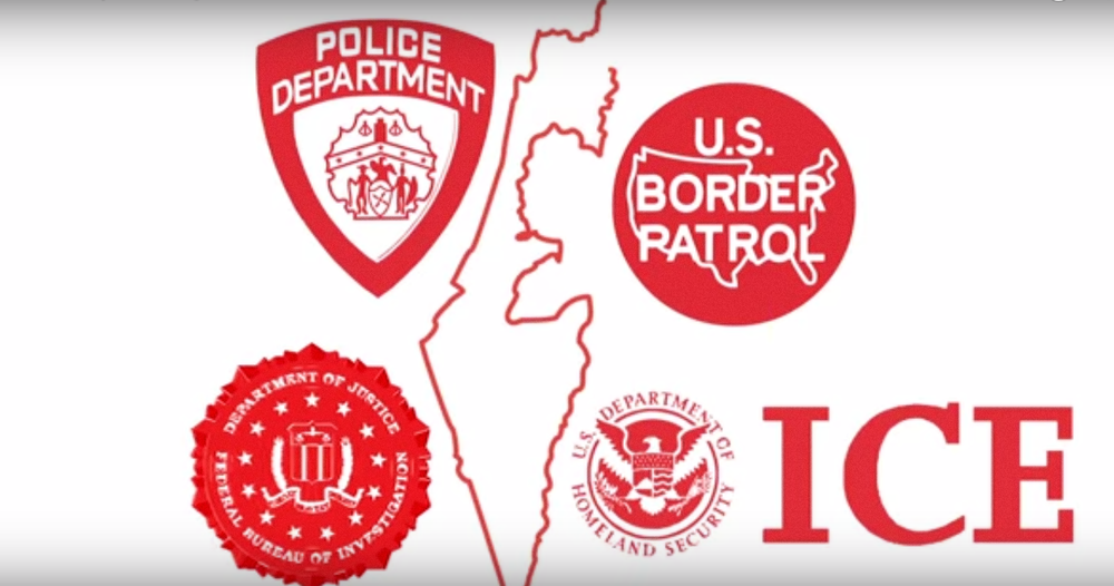 """Logos of U.S. government agencies surround a map of Israel in a scene from a video promoting Jewish Voice for Peace's """"Deadly Exchange"""" campaign, which opposes initiatives that promote joint training programs between American police and Israeli security forces. Credit: YouTube."""