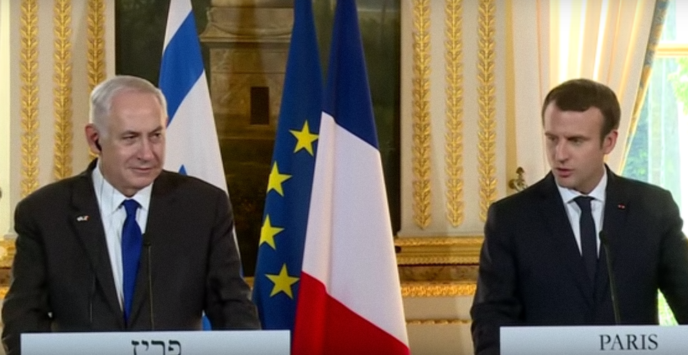 Israeli Prime Minister Benjamin Netanyahu (left) and French President Emmanuel Macron make a joint appearance Sunday in Paris. Credit: YouTube.