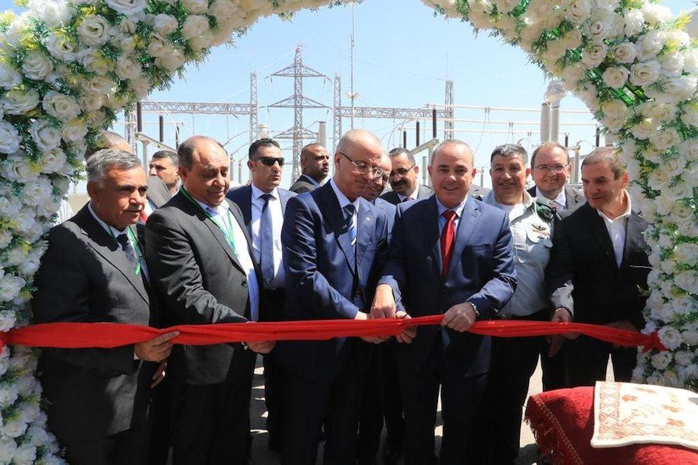 Israeli Energy Minister Yuval Steinitz (fourth from right) and Palestinian Authority Prime Minister Rami Hamdallah (to the left of Steinitz) attend a ribbon-cutting ceremony outside of Jenin to inaugurate the first Palestinian-owned power station July 10. Credit: Twitter.
