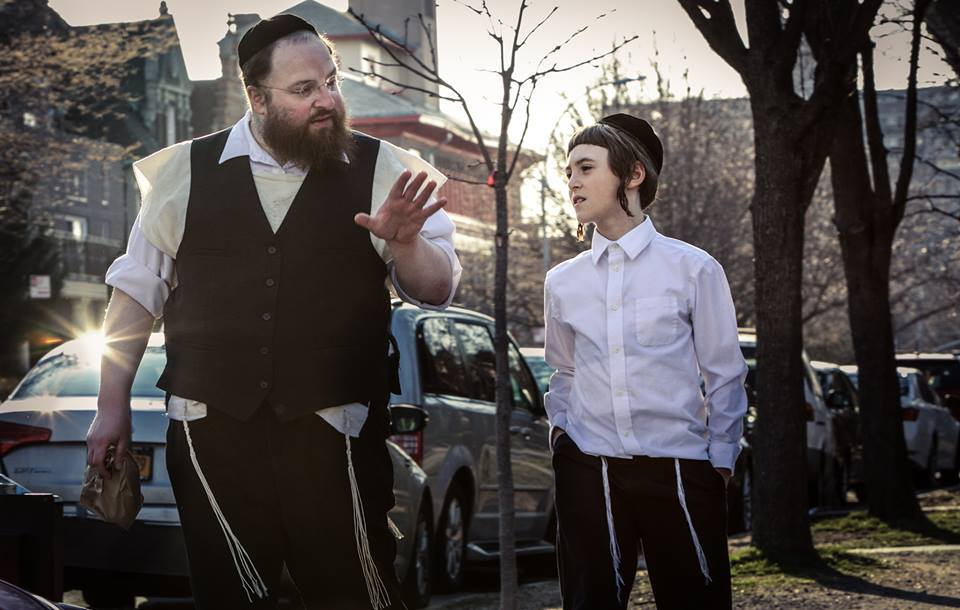 "Hasidic father Menashe and his son Rieven in the film ""Menashe."" Credit: Federica Valabrega."