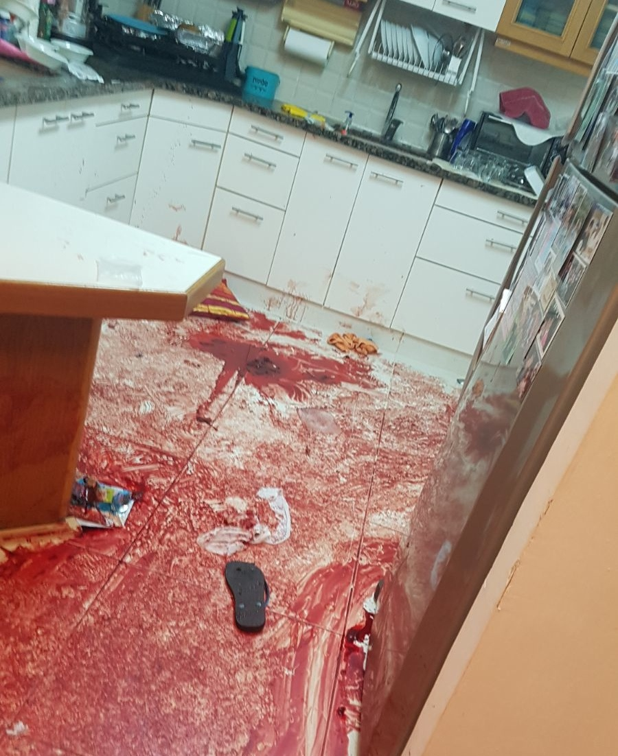 The bloody floor in the Salomon family home in Halamish following Friday's Palestinian terror attack. Credit: IDF Spokesperson's Unit.