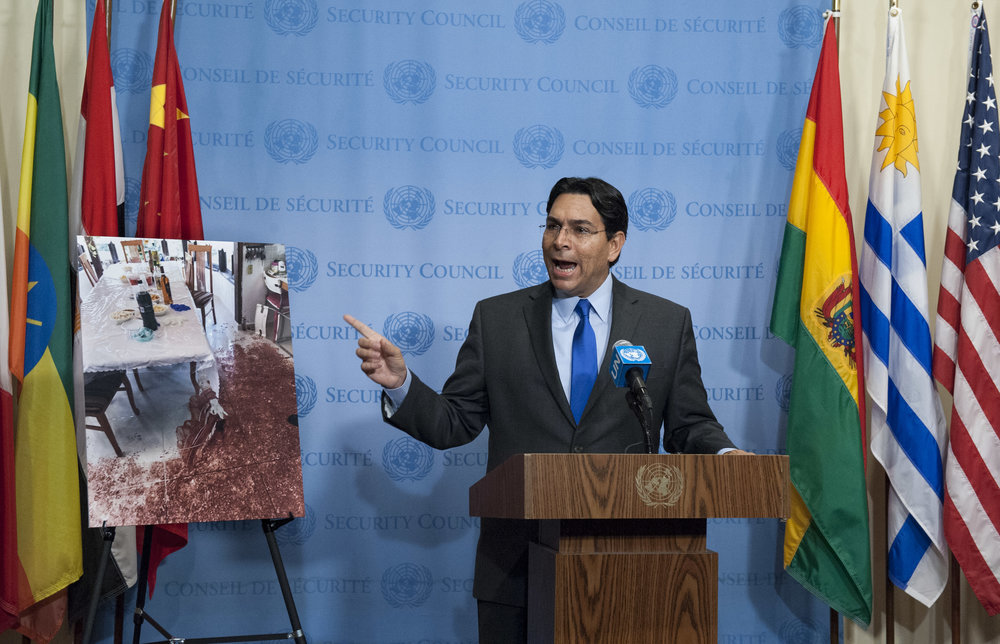 Israeli Ambassador to the United Nations Danny Danon show a gruesome photo from the crime scene of the Palestinian terror attack in Halamish at the U.N. Security Council Monday. Credit:U.N. Photo/Kim Haughton.