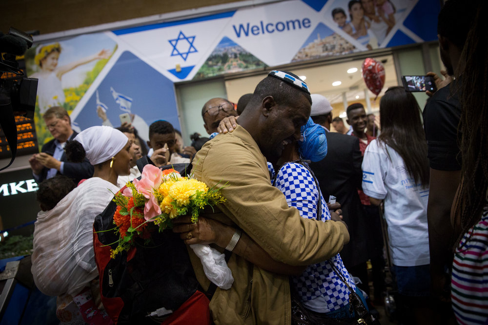 Ethiopian Jews are greeted by family members as they arrive at Israel's Ben Gurion Airport, as part of an aliyah flight arranged by The Jewish Agency for Israel and sponsored by the International Christian Embassy Jerusalem, in June 2017. Credit: Miriam Alster/Flash90.