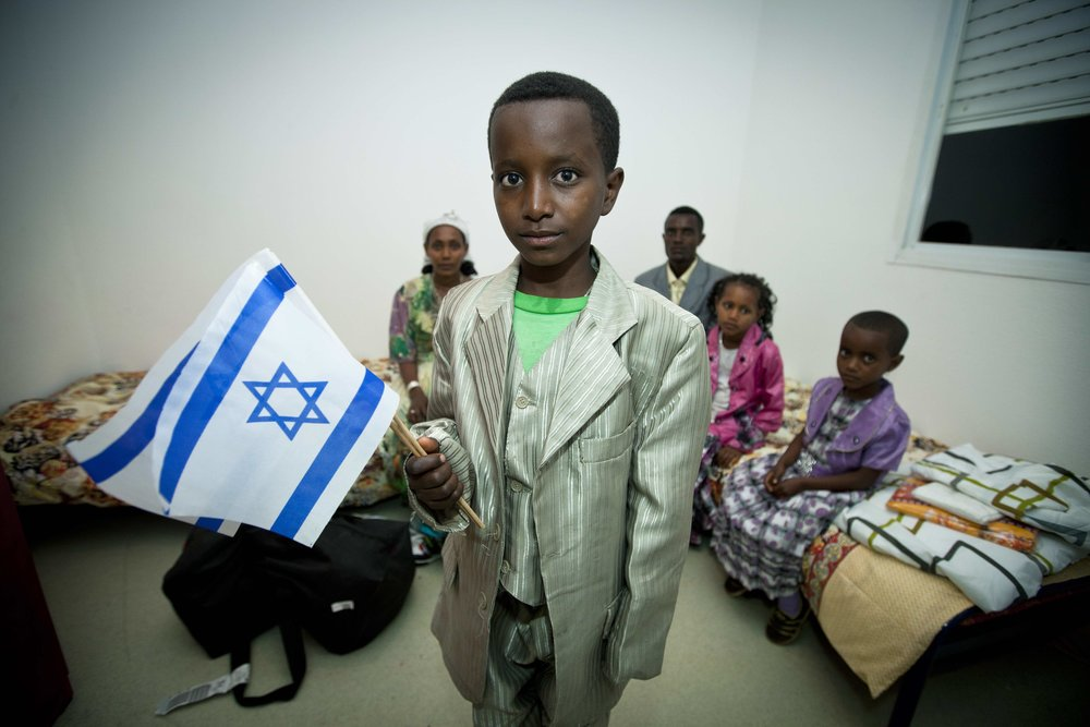 New immigrants from Ethiopia arrive at the Ibim Absorption Center in Jerusalem in October 2012, as part of aliyah and absorption efforts facilitated and funded by the International Fellowship of Christians and Jews. Credit: Moshe Shai.