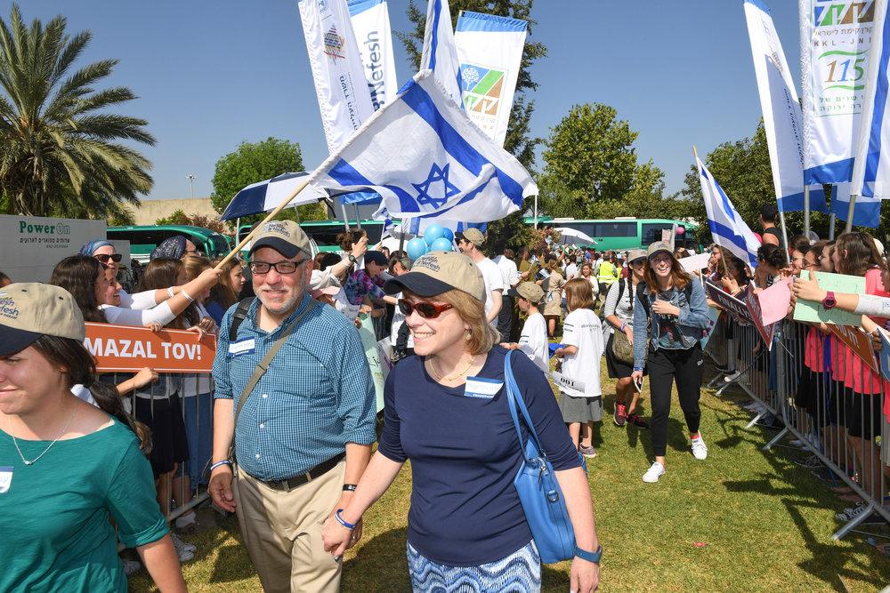 In front, the Lankin family from Highland Park, N.J., upon landing in Israel July 4, 2017, on a chartered flight through the Nefesh B'Nefesh aliyah agency. Credit:Shahar Azran, courtesy of Nefesh B'Nefesh.