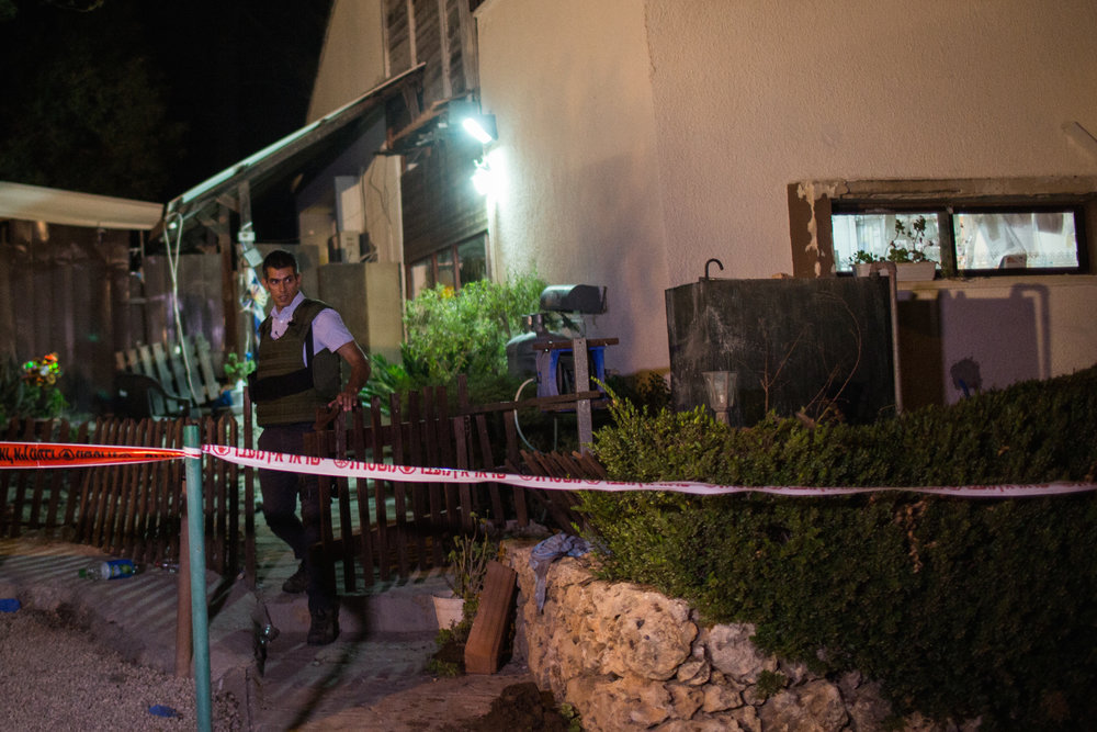 An Israeli security officer outside the home in Halamish where a Palestinian terrorist killed three members of an Israeli family July 21. Credit: Hadas Parush/Flash90.