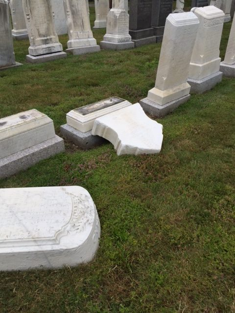 The desecrated headstones found July 28 at Netherlands Cemetery in Melrose, Mass. Credit: Melrose Police Department.