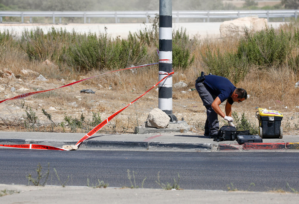 Israeli security forces at the scene of an attempted stabbing at the GushEtzionJunction in Judea and Samaria, July 28.Credit: Wisam Hashlamoun/Flash90.
