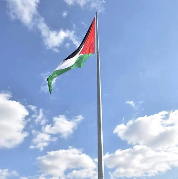 The Palestinian flag on a flagpole. (Illustrative.) Credit: Wikimedia Commons.