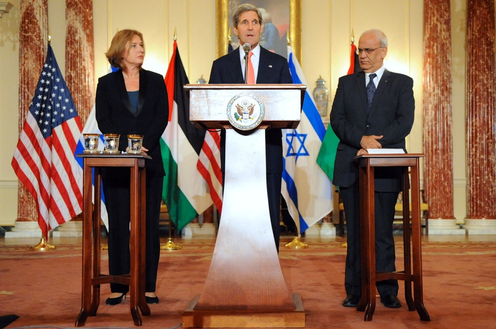 Then-U.S. Secretary of State John Kerry, then-Israeli Justice Minister Tzipi Livni and Palestinian chief negotiator Saeb Erekat address reporters during the most recent round of American-brokered Israeli-Palestinian peace talks in July 2013. Credit: State Department.