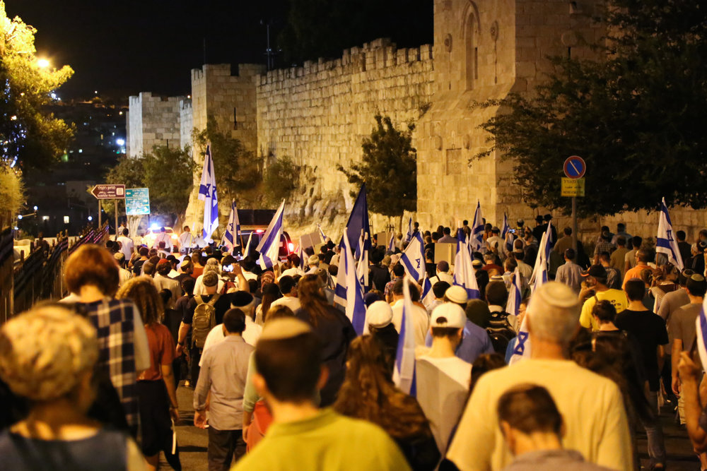 Thousands of Jews march in a demonstration around the walls of Jerusalem's Old City, calling on the Israeli government to allow Jewish prayer at the Temple Mount, on the eve of the Tisha B'Av day of Jewish mourning July 31. Credit: Gershon Elinson/Flash90.