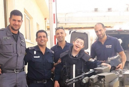 11-year-old Ilya Cohen (fourth from left) with police officers from Dimona, Israel. Credit: Israel Police.