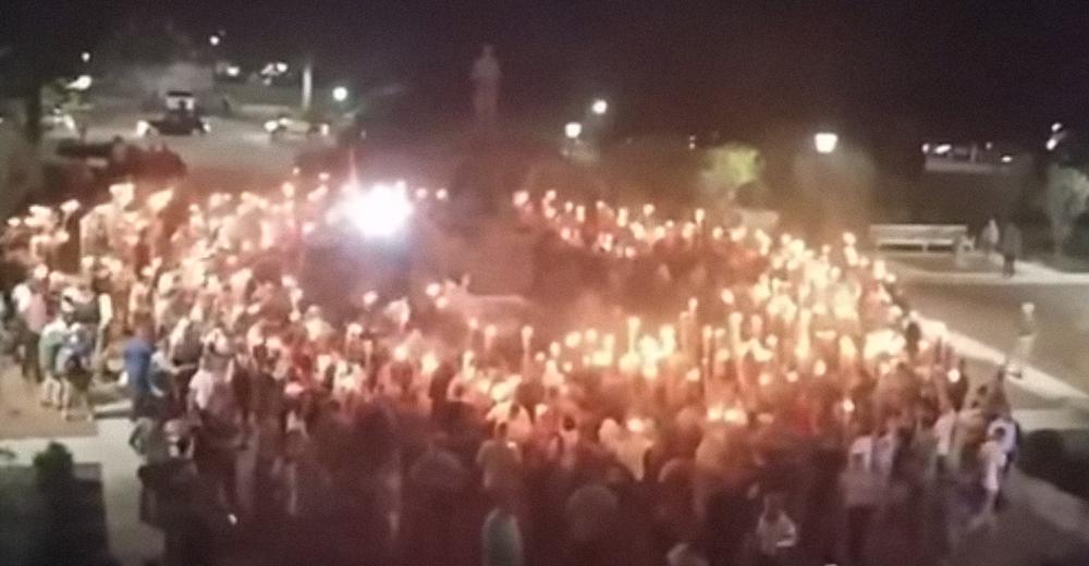 White supremacist protesters hold tiki torches in Charlottesville, Va. Credit: YouTube.