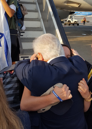 U.S. Ambassador to Israel David Friedman and his daughter, Talia, embrace Tuesday as Talia arrives in the Jewish state as part of a group of 233 new immigrants. Credit: Twitter.