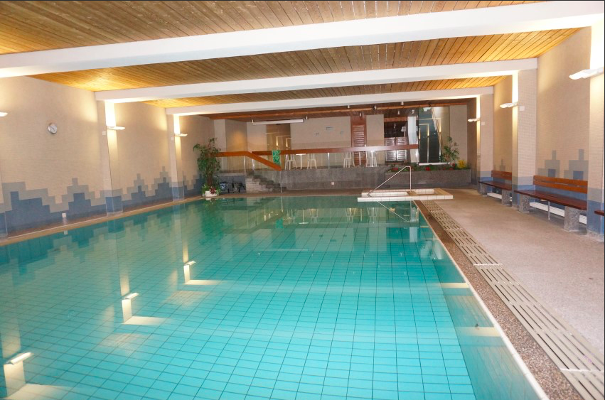 """The pool at the Paradies apartment hotel in Arosa, Switzerland that posted the sign """"To our Jewish Guests, women, men and children, please take a shower before you go swimming."""" Credit: paradiesarosa.ch."""