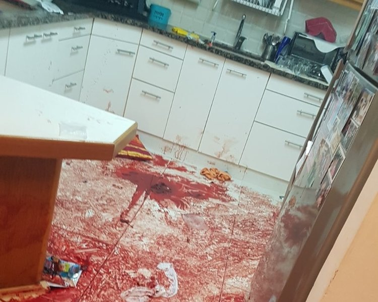 The bloody floor in the Salomon family home in Halamish following last month's Palestinian terror attack, in which Omar al-Abed fatally stabbed three members of the family. The Abed family home was demolished Wednesday. Credit: IDF Spokesperson's Unit.