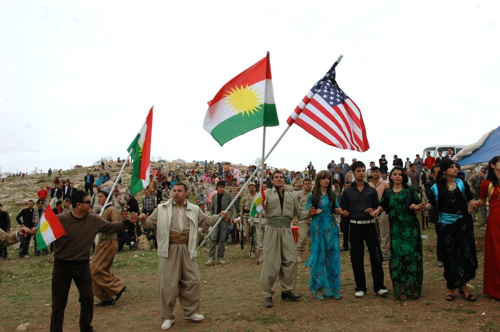 In Dahuk, a city in Iraqi Kurdistan, local citizens wave Kurdish and American flags during the Kurdistan Regional Government's celebration for the Kurdish New Year in 2008. Credit: U.S. Army photo by MND-N.