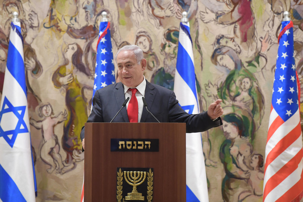 In June, Prime Minister Benjamin Netanyahu addresses a joint Knesset-Congress event for the 50th anniversary of Jerusalem's reunification. Credit: Amos Ben-Gershom/GPO.
