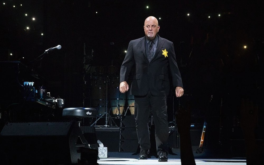 Billy Joel sports a yellow star on his jacket during a concert at New York City's Madison Square Garden. Credit: Billy Joel via Twitter.