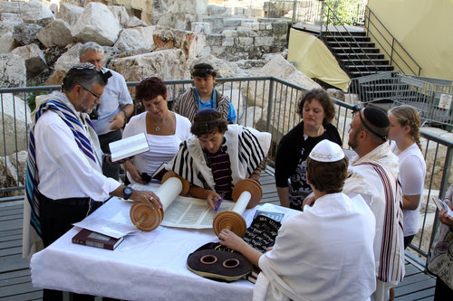 A mixed-gender Jewish prayer service at the Robinson's Arch compound, near the Western Wall's main worship area, in July 2014. Credit: Gershon Elinson/Flash90.