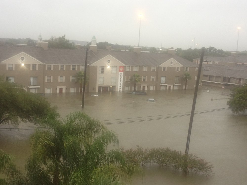 A view of the Houston flooding from a third-floor apartment at the intersection of North Braeswood Blvd. and Highway 610. Credit: Jacob Kamaras.
