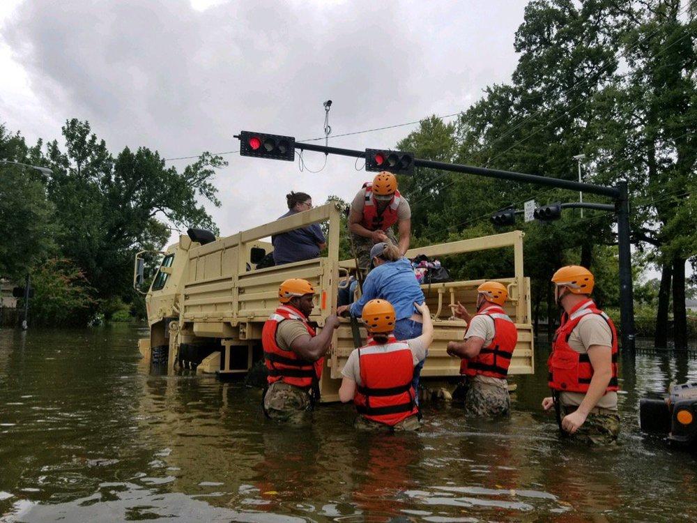 Texas National Guard members help rescue flooded Texans post Tropical Storm Harvey. Credit: Texas Gov. Greg Abbott via Twitter.