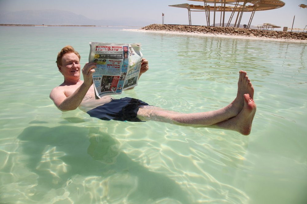 Conan O'Brien floats in the Dead Sea. Credit: Twitter.
