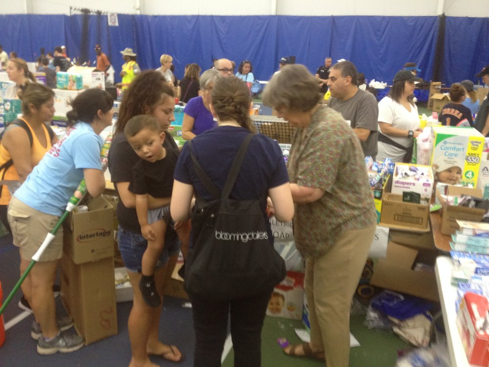 Volunteers at Houston's Evelyn Rubenstein JCC distribute supplies to those in need in the aftermath of Hurricane Harvey. Credit: Jacob Kamaras.