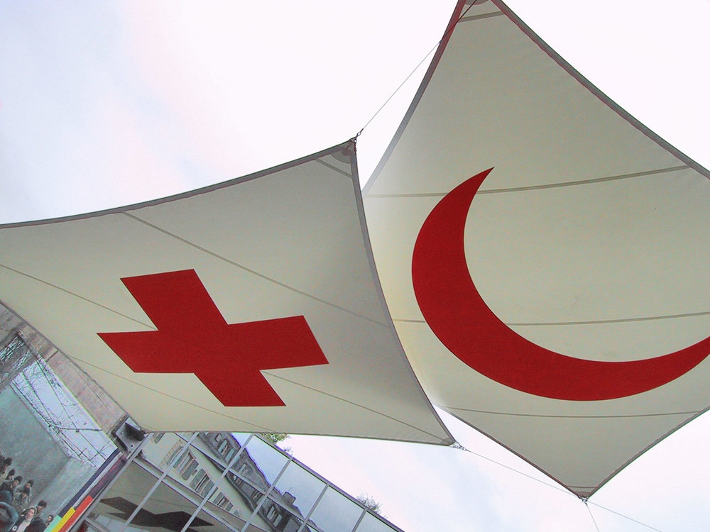 International Red Cross and Red Crescent emblems. Credit: Wikimedia Commons.