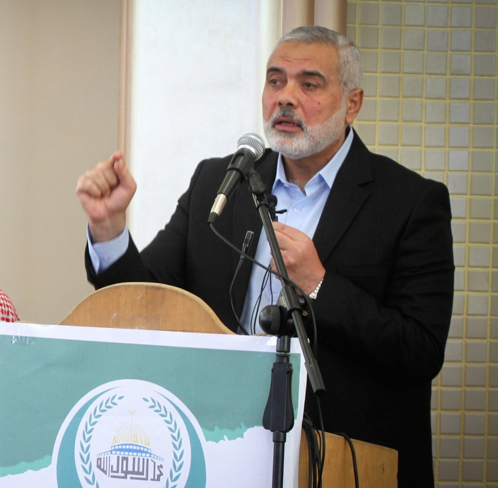Hamas leader Ismail Haniyeh (R) speaks in southern Gaza, Feb. 24, 2017. Credit: Abed Rahim Khatib/Flash90.