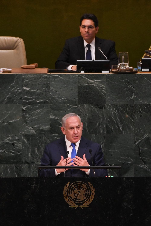 Israeli Prime Minister Benjamin Netanyahu addressing the U.N. as Israel's envoy to the U.N. Danny Danon presides over the General Assembly. Credit: Shahar Azran.