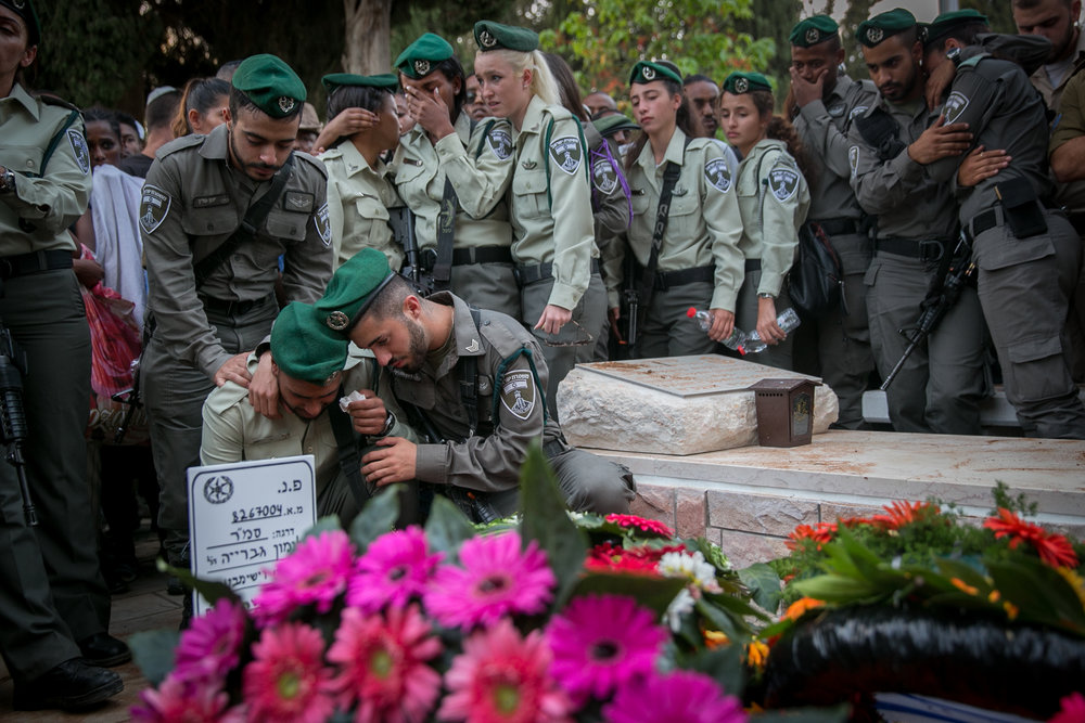 Israelis mourn slain Border Police officer Solomon Gavriyah, 20, during his funeral in Be'er Yaakov. Gavriyah was killed in a Palestinian terror attack Sept. 26 in Har Adar, near Jerusalem. Credit: Miriam Alster/Flash90.