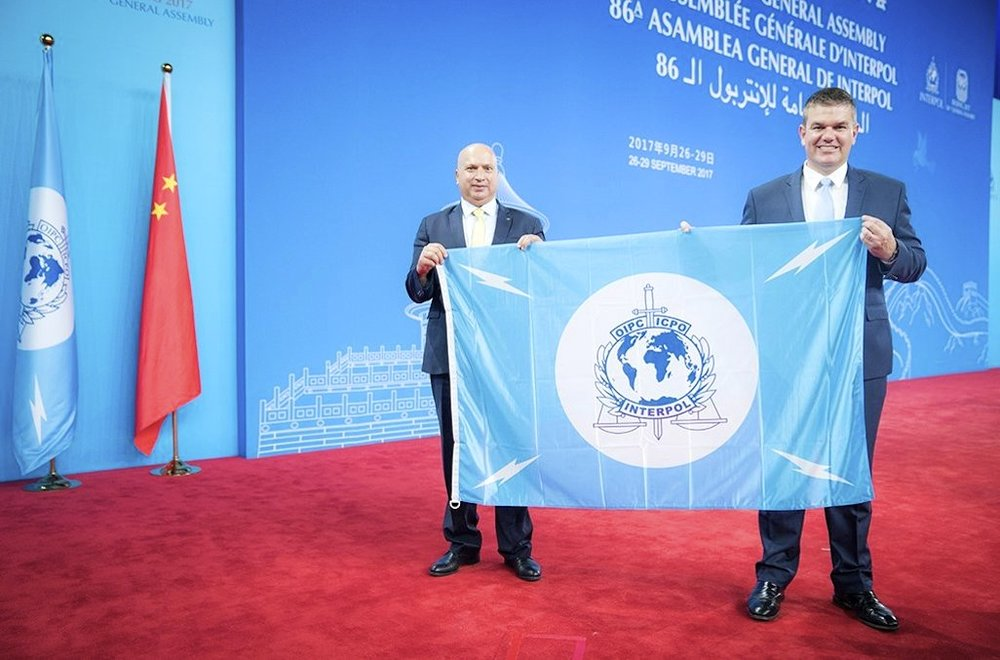 The Palestinians accept their Interpol flag at the international police organization's General Assembly in Beijing. Credit: Interpol.