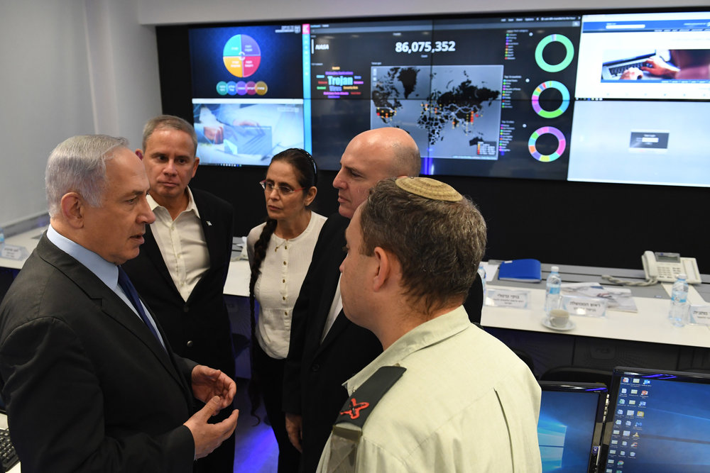 Israeli Prime Minister Benjamin Netanyahu (left) and Knesset Cyber Defense Subcommittee Chairperson MK Anat Berko (center) tour Israel's National Cyber Defense Authority facility in Be'er Sheva, July 27. Credit: Kobi Gideon/GPO.