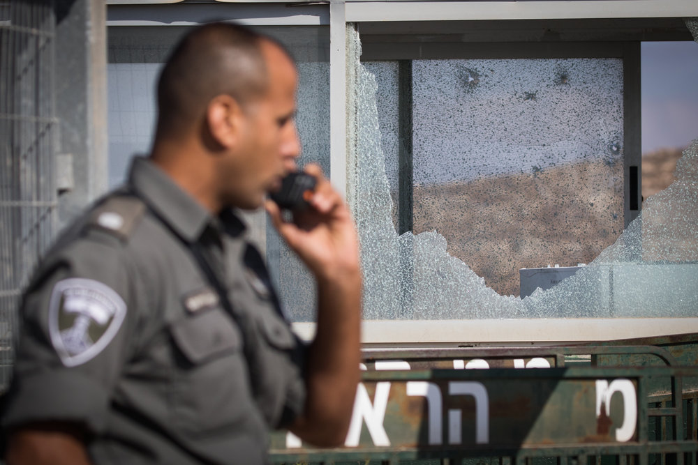 A security officer at the scene where a Palestinian terrorist killed three Israelis in a shooting attack in Har Adar, near Jerusalem, Sept. 26. Credit: Yonatan Sindel/Flash90.