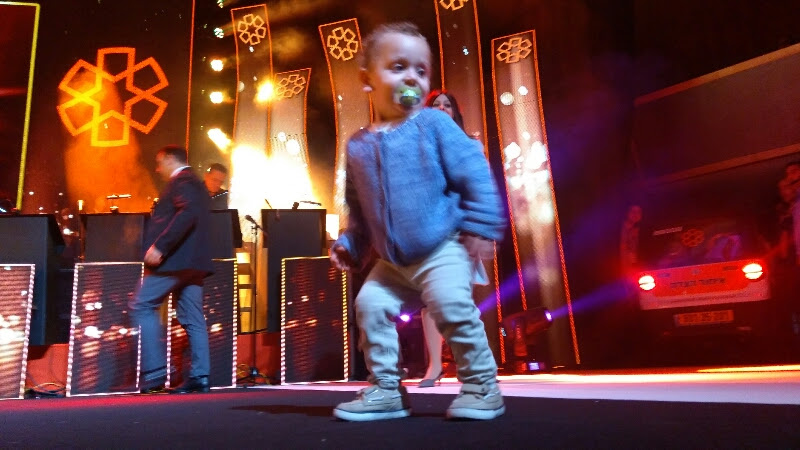 2-year-old Elchanan on stage at United Hatzalah's annual Sukkot concert Oct. 9, after he had nearly drowned Oct. 5 in Jerusalem. Credit: United Hatzalah