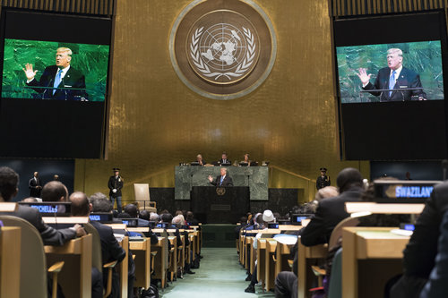 President Donald Trump, shown on screens, addresses the United Nations General Assembly Sept. 19. Credit: UN Photo/Mark Garten.