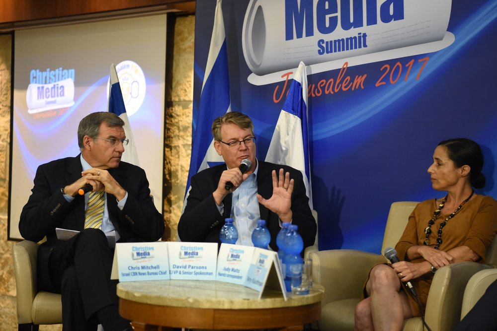 David Parsons (center), vice president and senior international spokesman for the International Christian Embassy Jerusalem, speaks on a panel at Israel's Christian Media Summit. Credit: Lihi Shapire/GPO.