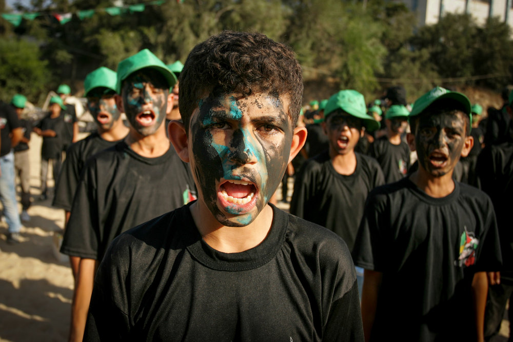 Palestinian youths at a graduation ceremony for a military-style camp organized by the Hamas terror group in Gaza, Aug. 18, 2017. Credit: Abed Rahim Khatib/Flash90.