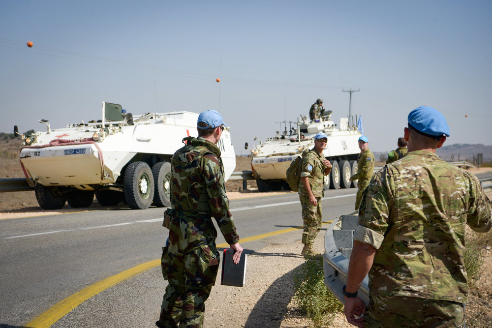 United Nations troops patrol near the Israeli-Syrian border in the Golan Heights after mortar shells landed in open fields in Israel, Oct. 21, 2017. Credit: Basel Awidat/Flash90.