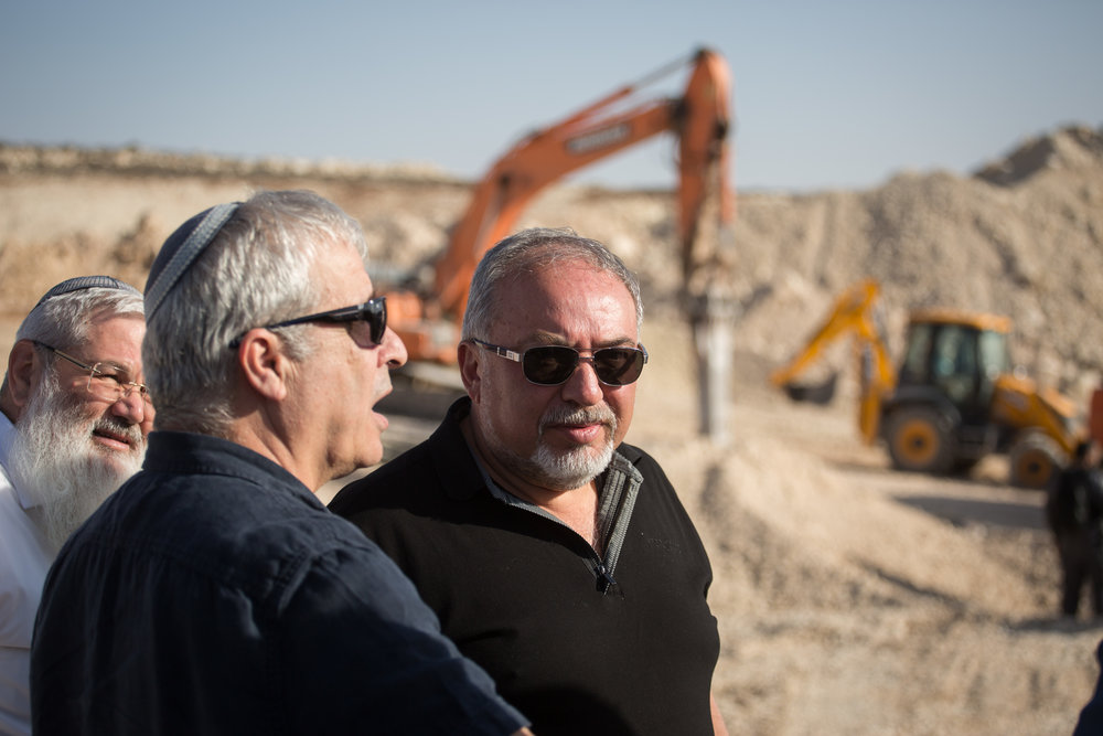 Israeli Defense Minister Avigdor Lieberman (center) visits the construction site for the new Israeli settlement of Amichai, the future home of evacuated residents of Amona, on October 18, 2017. Credit: Hadas Parush/Flash90.