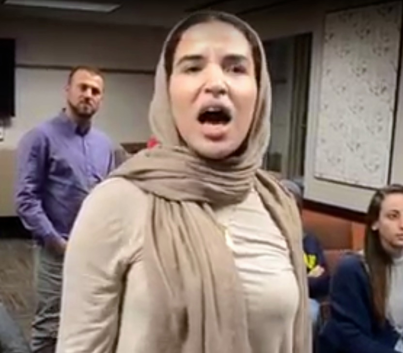 On Oct. 24 at the University of Minnesota, an unidentified woman disrupts a pro-Israel event featuring Arab Israelis who served in the IDF. Credit: Haym Salomon Center.